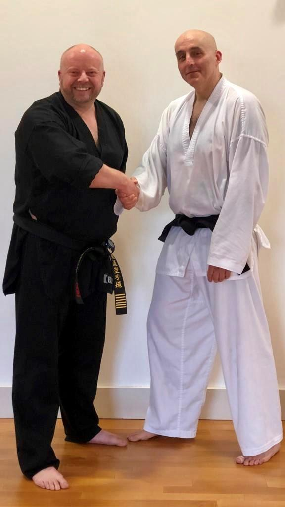 Ultimate Karate's new black belt Darren Robinson (right) with chief instructor Neil Bennett