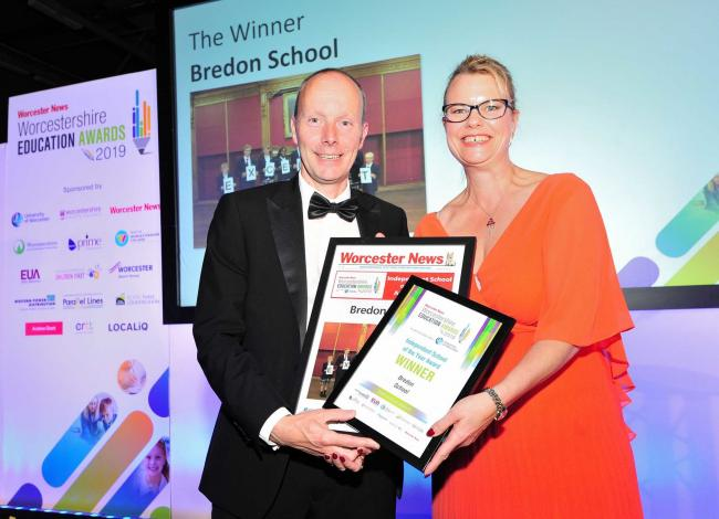 Sue Griffiths presents Bredon School Headteacher Koen Claeys with the award at the Worcester News Worcestershire Education Awards 2019, held at the University of Worcester Arena. Pic Jonathan Barry 20.6.19.