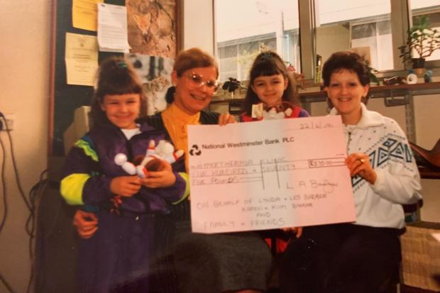 The sisters, when they were children, with their mother Lynda during a cheque presentation for one of her many charity drives.