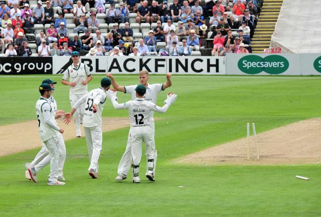 Action from day one of Worcestershire's Domestic First Class Multi Day match against Australia at New Road, Worcester.....Adam Finch celebrates with his Worcestershire team mates after bowling Marcus Harris for 14...Pic Jonathan Barry 7.8.19.
