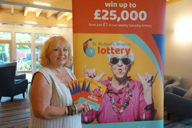 First winner of hospice lottery celebrates winning prize