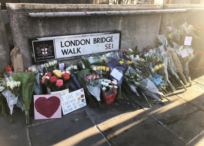 Flowers left at London Bridge in central London, following the London Bridge terror attack on Friday. A vigil will be held on Monday to pay tribute to the victims of the attack and to honour the emergency services and members of the public who responded t