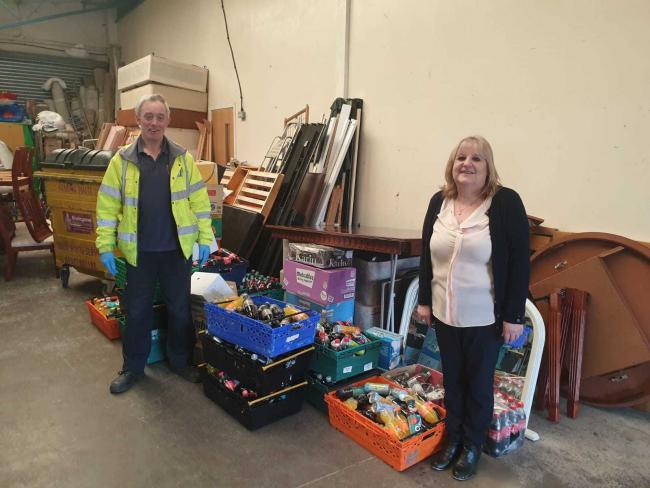 Staff at New Starts with some of the food bank donations made at Bromsgrove Sporting.