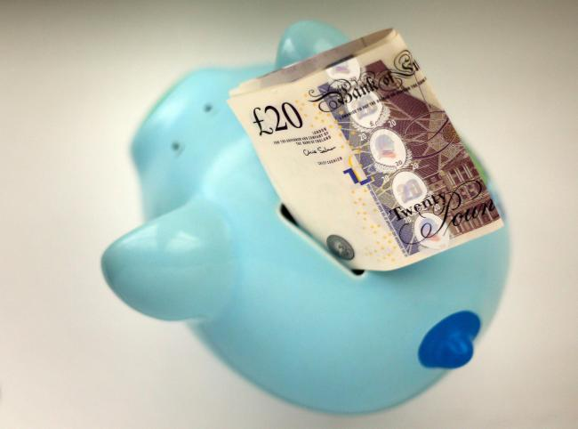 PIGGY BANK: Furlough - How the workers scheme works - and if you still have to pay taxes. Picture: PA Wire