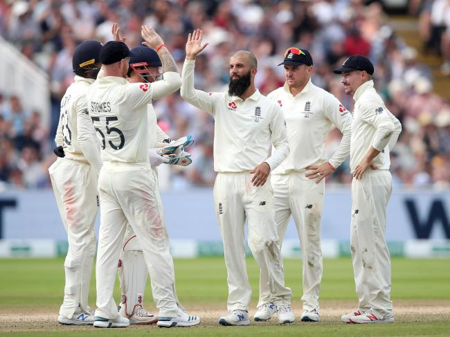 OUT: Moeen Ali surrounded by his England teammates celebrating the wicket of Australia captain Tim Paine during the Edgbaston Ashes Test last year. Pic. PA Photo