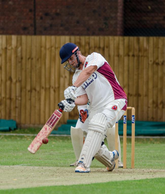 CRICKET: Martley's Dan Johnson hits out on his way to an unbeaten 77. Pic. Roger King