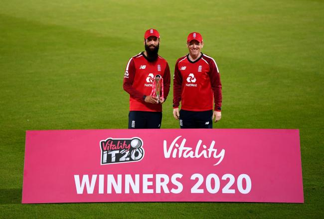 England's Moeen Ali (left) and Eoin Morgan celebrate with the trophy after winning the Vitality IT20 series against Australia at the Ageas Bowl, Southampton in September. Pic: Dan Mullan/NMC Pool/PA Wire.