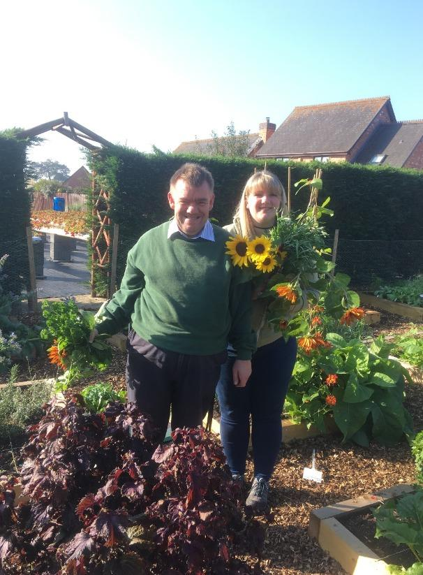WELLBEING: A Well Bean Gardening Club member with one of Link Nurseries' occupational therapy students.