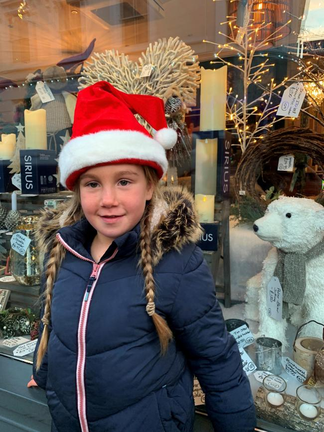 CHRISTMAS: Youngster Sydney Williams outside a festive shop window in Great Malvern.