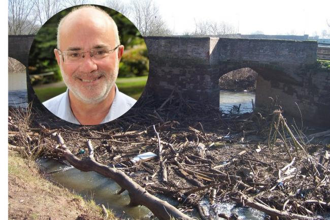 CLOGGED: Cllr Tom Wells is concerned at storm debris under a Powick bridge impeding the flow of water which could result in habitat damage (Credit: Powick Village News Facebook)