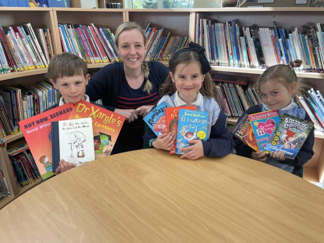 BOOKS: Robin Townsend, Callie Manford and Elsie Humm with school reading head Mrs Tedds