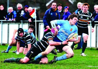 Malvern's Tom Longley (right) is challenged during his side's 29-5 victory over Scunthorpe.
