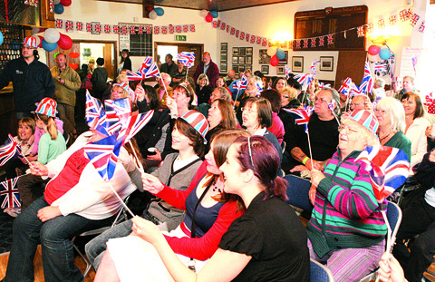 Support: Upton residents wave their flags during the wedding of Prince William and Kate Middleton.