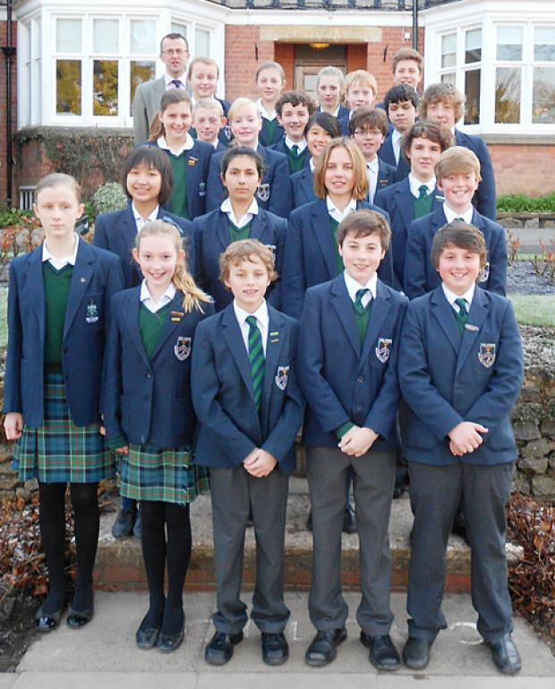 The 22 Downs pupils who were awarded 28 scholarships, with, back left, Mark Stubbs, director of studies at the school.