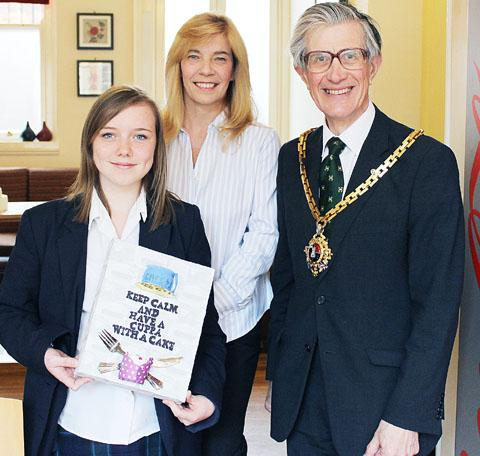 PLACEMATS: Pupil Danielle Greening, Cafe 43 owner Sue Poluczanis and David Tibbutt.