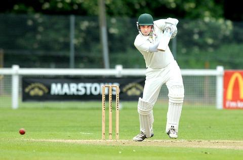 Barnards Green's Elliot Hennessy drives the ball through mid-wicket during his side's five-wicket loss to Old Elizabethans in Birmingham and District League Division.