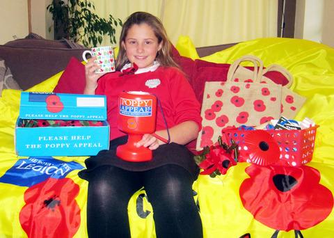 WELL-EARNED REST: Megan Boffy's hard work raised £400 for the Poppy Appeal.