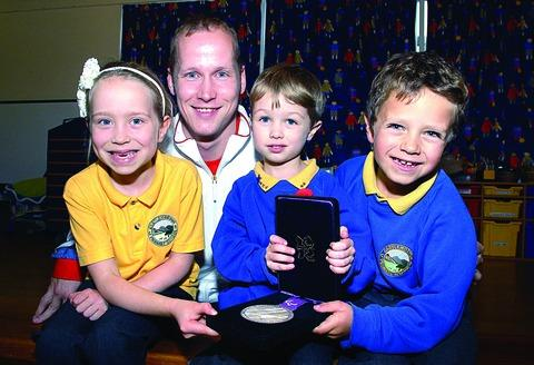 INSPIRED: Paralympic swimmer Sascah Kindred is pictured with Castlemorton Primary School pupils Daniella Pomroy, aged sic, Ned Tranmer, five and Alistair Cresswell, seven. 45173001