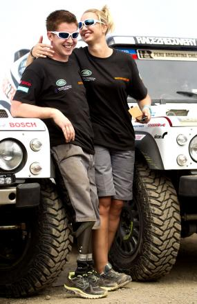 READY TO ROLL: Cpl Tom Neathway and co-driver Cathy Derousseaux in relaxed mood before today's race.
