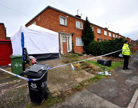 CRIME SCENE: A policeman on duty outside the scene of the killing in Teme Road, Worcester. 0113214801