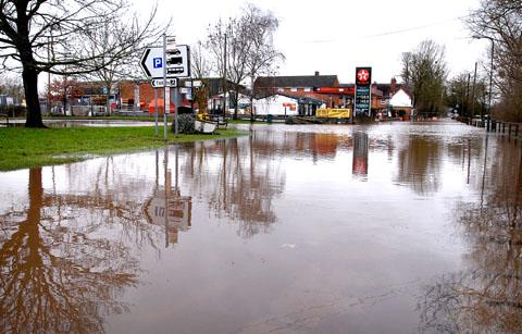Flooding closes riverside road again