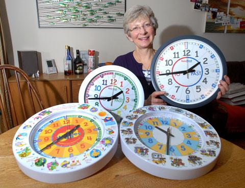 CHANGING TIMES: Sue Shackleton with some of her clocks