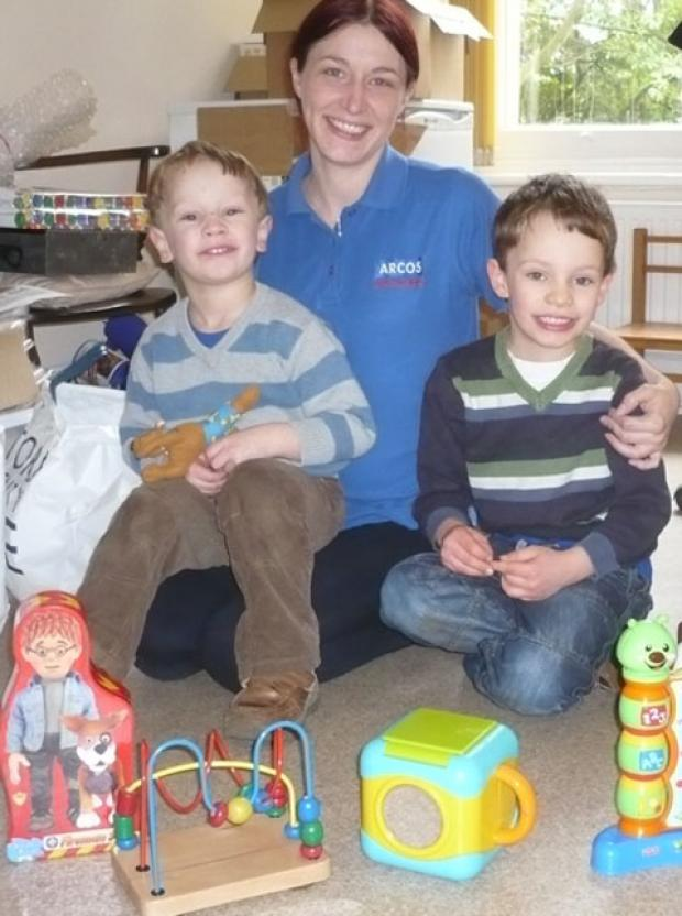 SMILES: Samantha Jones with Jacob Matthews, aged four, and Nathan Matthews, six.