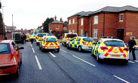 SWOOP: Police cars and officers swoop on Worcester Road, Malvern Link, to arrest a man near Lidl supermarket. Picture taken by Malvern Gazette reader.