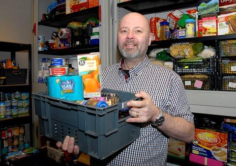 HELPING HAND: Steve Geal with some of the donated food that is being stored at the town's new foodbank, which has already been distributing goods to the needy. Picture by Nick Toogood. 0313222701.