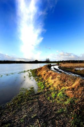 WATER WORLD: Flooded farmland on the outskirts of Upton. Picture by John Anyon. 0513233 104.