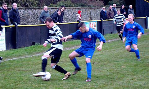 IN CONTROL: Ledbury Town's Neil Gardiner (black and white shirt) attempts to retain possession on the wing during his side's 9-1 win over Red Star Alma on Saturday. Picture: CHRIS PONTER