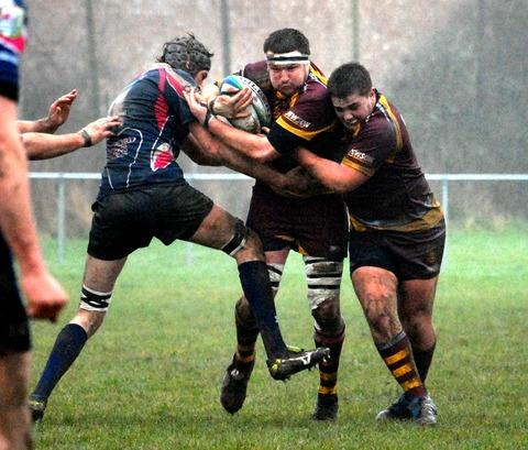 ON THE CHARGE: Matthew Williams (centre) in action for Malvern in their 13-7 victory over Oxford Harlequins in National League Three South West. 0613241706