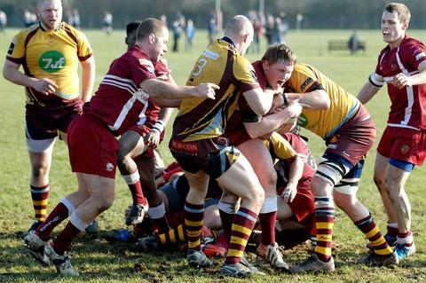 GOING NOWHERE: Malvern's Tim Pickard (number 3) wrestles with an Amersham and Chiltern player during the 33-73 defeat last Saturday. Picture by Nick Toogood. 0913260004
