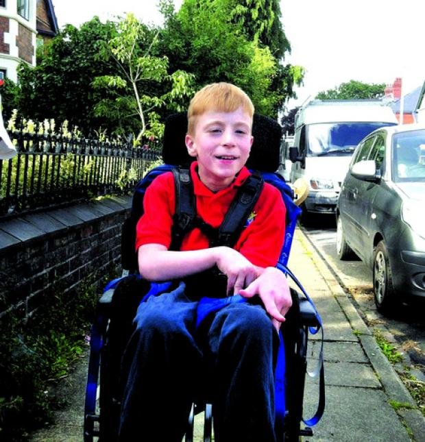 SETTLEMENT: Daniel Spencer, aged 11, needs 24-hour care.