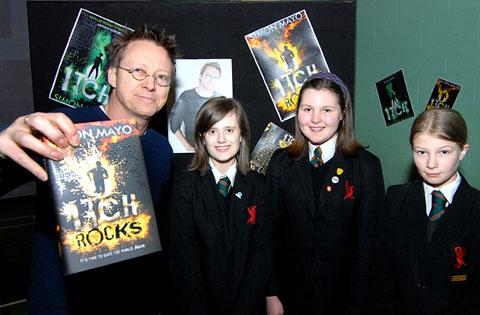 DJ and author Simon Mayo with Hanley Castle High School pupils Mel Daffin, Katie Gayton and Vicky Ayling.