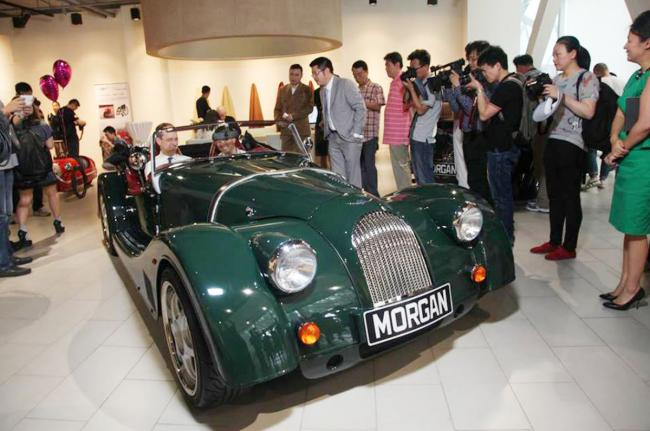 EXPORT SUCCESS: Chinese customers and the national media gather for the opening of Morgan's store in Beijing.
