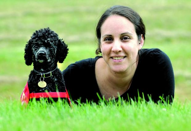 ME AND MY PAL: Yasmine Tornblad with her nut detection dog Nano. Picture by Nick Toogood 2713352101