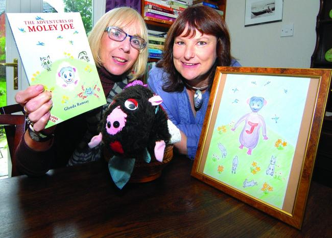 HOLY MOLEY: Author Glenda Ramsay, left, and illustrator Wendy Britton with character Moley Joe who is the suject of a new book. Picture by Nick Toogood. 4313435801.