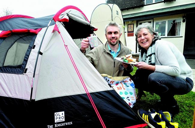 "SLEEP-OVER RATHER THAN LOCK-IN: Lizzie Jennings and Olpro boss Daniel Walton at the Drum and Monkey's ""drunk tank"" under canvas near Upton. Picture by Chas Breton."