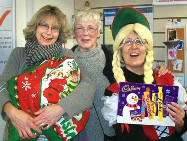 SWEET SUCCESS: Councillors Angela Conway and Rosemary Webb present boxes of goodies to Sarah Langford, manager of the Acorns Children's Hospice shop in Old Street.