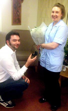 WILL YOU MARRY ME? Nervous Andy Young gets down on one knee to propose to Helen Jenkins at the care home.