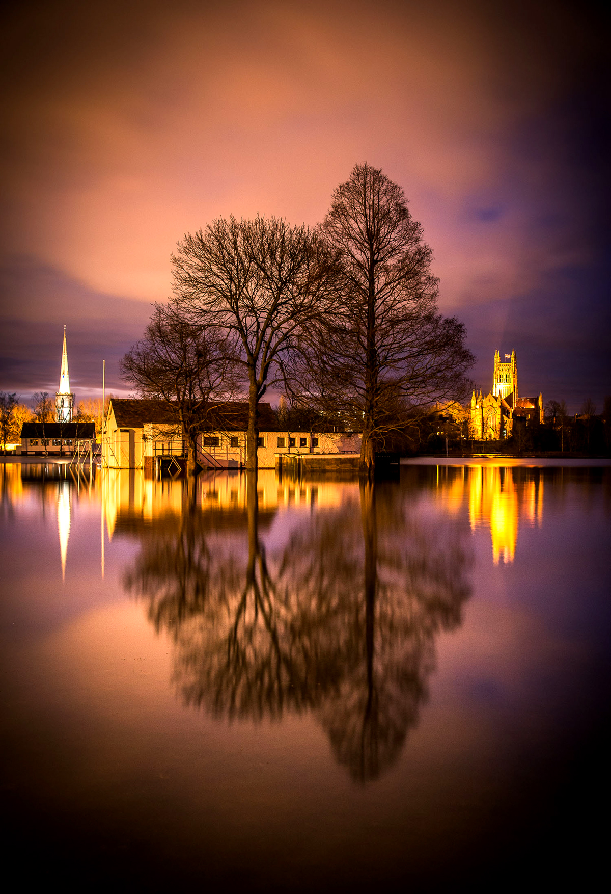 Worcester Cathedral basks in the evening light, reflected in floodwater. Picture by Jan Sedlacek.