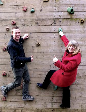 FUTURE SECURE: Nick Hands from the Malvern Outdoor Elements centre demonstrates the climbing wall to Harriett Baldwin MP, before she was shown around the centre.