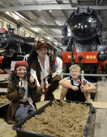 William Murdock, aged seven, Charlie Murdock, four, and 'Captain' Geoff (Engine House volunteer) enjoying activities at The Engine House in Highley during Pirate Time week as part of the Steam and Whistle activity club last summer.