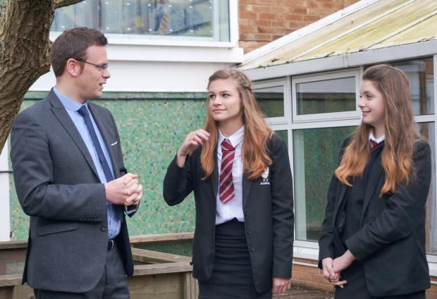 Dyson Perrins headteacher Stuart Wetson talks to pupils Pippa Hayes and Kiera Butler.