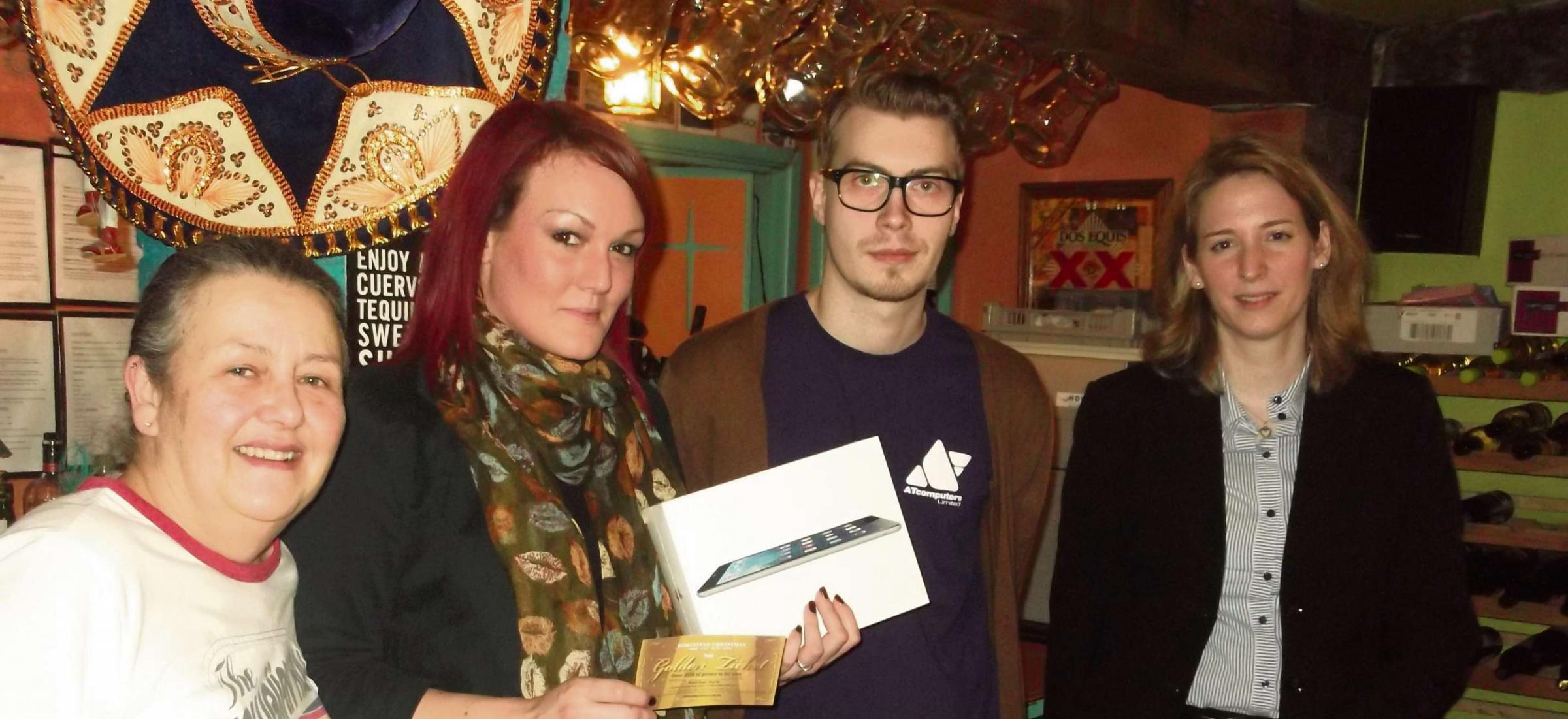 Julie Stafford, from Amigos, Michelle Jenkins, iPad Air winner, Ryan Hanke, from AT Computers and Nadja von Dahlen, from Worcester BID.