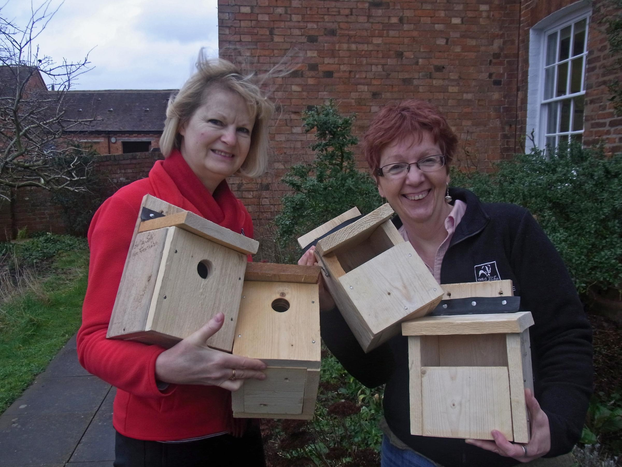Julie Allen (left) and Anne Williams (right) with some of the bird boxes.