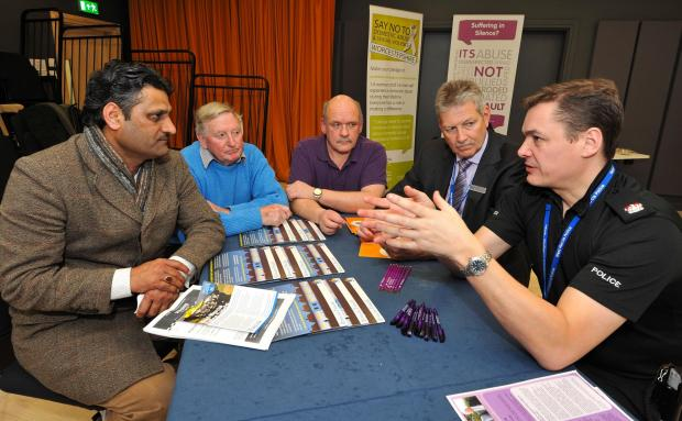 John Anyon             5/2/14           0614514401West Mercia Police meet the public at The Hive on Wednesday.........................Superintendent Mark Travis and Deputy Commissioner, Barrie Sheldon talk to Haris Saleem, John Hewlett and Graham Houghton
