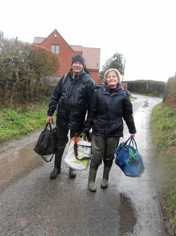 Malvern Gazette: Mike and Anna Briggs after their rescue from the floods in Callow End. Pic James Connell (3975899)