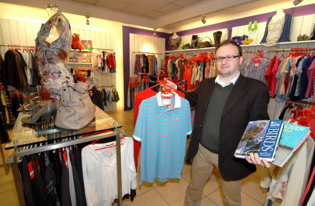 Malvern Gazette: 19/02/14. Retail Area Manager at YMCA James Preece inside the new YMCA charity shop in Church Street, Malvern. Picture by Nick Toogood. (4212830)